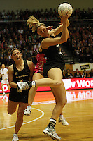 NZ goalkeep Casey Williams takes an intercept during the International  Netball Series match between the NZ Silver Ferns and World 7 at TSB Bank Arena, Wellington, New Zealand on Monday, 24 August 2009. Photo: Dave Lintott / lintottphoto.co.nz