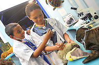 Donovan Obajinmi, 9, and his brother Joseph, 8, check the vital signs of a Pelican at  Santa Monica Pier Aquariums new science lab during Heal the Bays Earth Day theme weekend on Saturday, April 21, 2012.