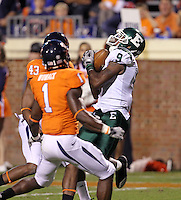Oct 23, 2010; Charlottesville, VA, USA;  Eastern Michigan Eagles wide receiver Tyrone Burke (9) makes a catch in front of Virginia Cavaliers cornerback Mike Parker (43) and Virginia Cavaliers safety Trey Womack (1) during the game at Scott Stadium.  Virginia won 48-21. Mandatory Credit: Andrew Shurtleff