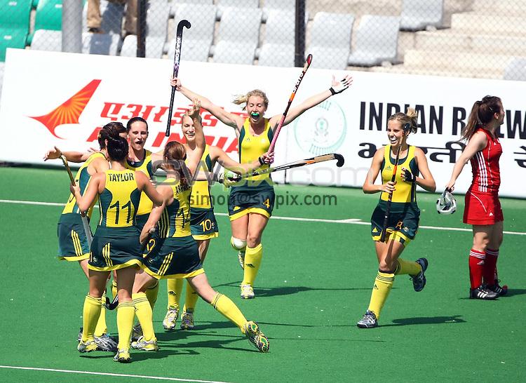 PICTURE BY VAUGHN RIDLEY/SWPIX.COM - Hockey - XIX Commonwealth Games - Women's Semi-Finals, England v Australia, Major Dhyan Chand National Stadium, New Dehli, India - 11/10/10...Copyright - Simon Wilkinson - 07811267706...Australia's Madonna Blyth scores.