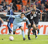 Sporting Kansas City midfielder Omar Bravo (99) shields the ball against D.C. midfielder Perry Kitchen (23).  Sporting Kansas City defeated D.C. United 1-0 at RFK Stadium,Saturday October 22, 2011.