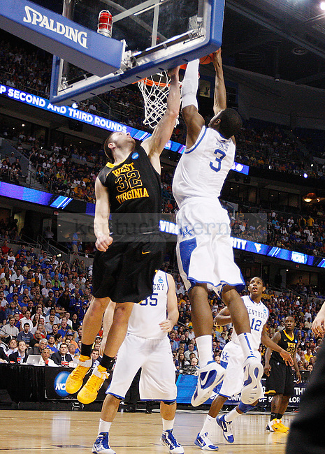 Terrence Jones makes a dunk in the second half of UK's second round NCAA tournament win, 71-63, against West Virginia at the St. Pete Times Forum in Tampa, Florida on Saturday, March 19, 2011.  Photo by Britney McIntosh | Staff