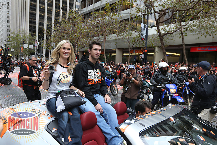 SAN FRANCISCO - OCTOBER 31:  Buster Posey of the San Francisco Giants waves to the fans on Market Street during the World Series parade on October 31, 2012 in San Francisco, California. (Photo by Brad Mangin)