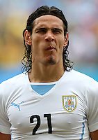 Edison Cavani of Uruguay pulls a face as the teams line up
