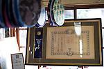 Masao Uyama, 81 makes Boshu Uchiwa fans at his atelier in Tateyama, Chiba Prefecture, Japan on 21 Jan. 2013. Uchiyama has been making the traditional bamboo fans for 63 years. Photographer: Rob Gilhooly