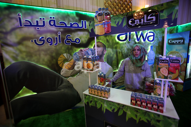 Palestinians attend the opening ceremony of al-Quds exhibition for Palestinian food industry, in the West Bank city of Nablus, March 1, 2015. Photo by Nedal Eshtayah