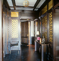 In the entrance hall intricate fretwork walls have been fitted with glass panels treated with gold and copper leaf with a vintage bronze ceiling light in the centre