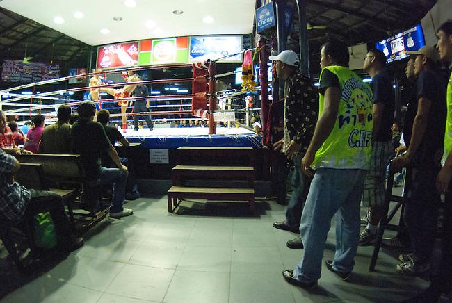 Bangkok, August 30, 2011, Lumpini Muay Thai kick boxing stadium; trainers from Kai Yang Ha Dao gym watch as their fighter Akemongkol battles Yodvicha