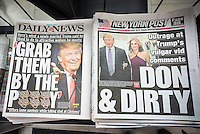 New York newspapers on Saturday, October 8, 2016 report on the Republican presidential candidate Donald Trump's New York papers report on Republican presidential misogynistic comments. The comments were released by the Washington Post and took place on a hot mike during an NBC television appearance in 2005. (© Richard B. Levine)