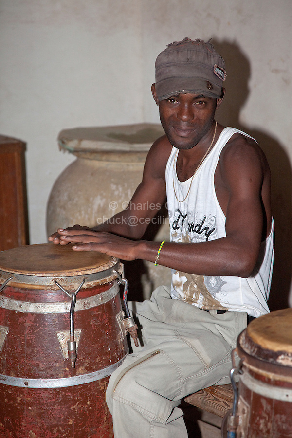 Cuba, Trinidad.  Drummer at Afro-Cuban Religious Ceremony.