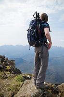 Female hiker near summit of Bla Bheinn Blaven, Black Cuillins, Isle of Skye, Scotland