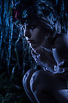 Conceptual image of young adult female in the woods