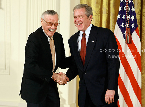 Washington, DC - November 17, 2008 -- United States President George W. Bush congratulates Stan Lee, founder of POW! Entertainment before presenting him with the 2008 National Medals of Arts award during an event in the East Room at the White House on Monday, November17, 2008 in Washington, DC. During the event president Bush presented recipients with awards for the National Medals of Arts and the National Humanities Medal. .Credit: Mark Wilson - Pool via CNP