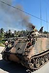 Australian troops provide protection for East Timorese firefighters, the Bombeiros, as they attempt to put out a major fire lit by fueding gangs. Acts of arson across Dili have become a continual occurence. 030606
