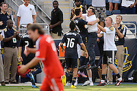 Sebastien Le Toux (9) of the Philadelphia Union celebrates scoring the game winning goal with head coach Peter Nowak. The Philadelphia Union defeated Toronto FC 2-1 on a second half stoppage time goal during a Major League Soccer (MLS) match at PPL Park in Chester, PA, on July 17, 2010.