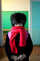 A girl at the school in Oymyakon prepared to walk home with a warm fur cap. The village is known as the Northern Pole of Cold as it has recorded the lowest ever temperatures for an inhabited place on earth, the coldest being -67.7 degrees celcius.
