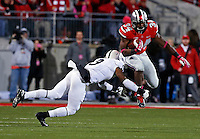 Ohio State Buckeyes running back Carlos Hyde (34) leaps past Penn State Nittany Lions cornerback Jordan Lucas (9) during the first half of the NCAA football game at Ohio Stadium in Columbus on Oct. 26, 2013. (Adam Cairns / The Columbus Dispatch)
