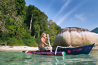 Kampung Air Batang, Pulau Tioman Island, Malaysia, October 2010. Richard (Rick) Sills of South Sea Nomads on his self built boat 'my pebbles' travels the seas between the Perhentian Islands and Tioman with backpackers, snorkelers and divers.  Tioman Island is a tropical island paradise off the east coast of Malaysia. Independent tourists come here to relax on the palm fringed beaches, for diving and snorkeling or for trekking through the rainforest. Photo by Frits Meyst/Adventure4ever.com