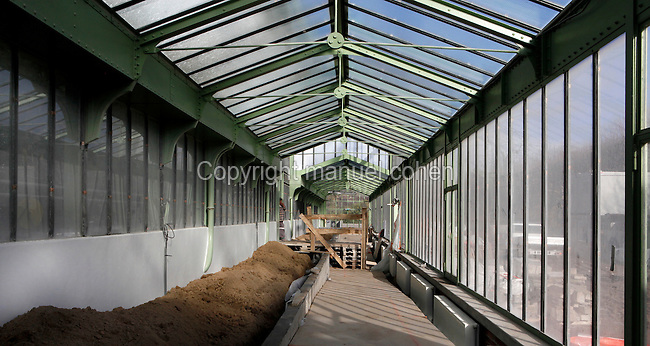 Desert and Arid Lands Glasshouse, 1930s, Jardin des Plantes, Museum National d'Histoire Naturelle, Paris, France. Low angle view of  the troughs filled with with a mixture of loam and sand in which the cactuses will be planted .