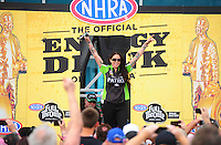 Mar. 11, 2012; Gainesville, FL, USA; NHRA funny car driver Alexis DeJoria during driver introductions prior to the Gatornationals at Auto Plus Raceway at Gainesville. Mandatory Credit: Mark J. Rebilas-