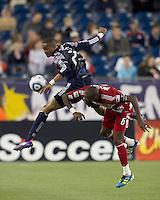 New England Revolution defender Darrius Barnes (25) and FC Dallas midfielder Jackson Goncalves (6) battle for head ball. In a Major League Soccer (MLS) match, the New England Revolution defeated FC Dallas, 2-0, at Gillette Stadium on September 10, 2011.