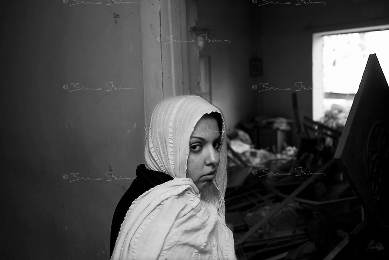 Baghdad, Iraq, March 23, 2003.Zahar, 28, a doctor, was sleeping under the stairs of her house when a US bomb exploded less than 25 meters away and completely destroyed the house next door; miraculously she was unscathed and says the copy of the Holy Coran she kept in her bed saved her life.