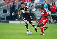 August 21 2010   D.C. United forward Pablo Hernandez #21 and Toronto FC defender Nana Attakora #3 in action during a game between DC United and Toronto FC at BMO Field in Toronto..DC United won 1-0.