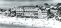 BNPS.co.uk (01202 558833)<br /> Pic: PHT/BNPS<br /> <br /> The Sandbanks Hotel is one of the earliest buildings on the exclusive peninsula.<br /> <br /> Plans to transform the millionaire's resort of Sandbanks into 'Britain's Miami Beach' with two new superhotel's and apartments as part of a &pound;250m development have been unveiled. <br /> <br /> A pair of century-old hotels on the exclusive Dorset peninsula will be bulldozed to make way for an extravagant five star hotel on the beach and a smaller hotel with apartments on the cliffs above.<br /> <br /> The luxurious 175 room establishment will replace the existing Sandbanks Hotel, a former Victorian seaside villa built in the 1880s that is now 'coming to the end of its economic life cycle.'<br /> <br /> In keeping with the Miami Beach look, the super hotel will be Art-Deco in style, have curved floors and painted white with palm trees in the grounds.<br /> <br /> The existing historic Harbour Heights Hotel will also be demolished to make way for the second part of the radical development.