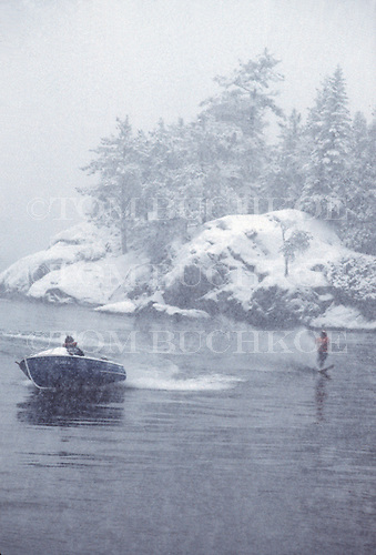 Yoopers from the Upper Peninsula of Michigan fight  boredom by firing up the speedboat and do some winter water skiing on Lake Superior.