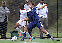 HYATTSVILLE, MD - OCTOBER 26, 2012:  Chris Odoi-Atsem (18) of DeMatha Catholic High School is tackled by Camyer Matini (5) of St. Albans during a match at Heurich Field in Hyattsville, MD. on October 26. DeMatha won 2-0.