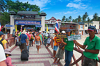 Hotel agents holding signs with the names in the port of Phi-Phi island, Thailand