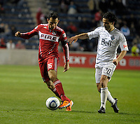 Chicago midfielder Marco Pappa (16) maneuvers away from Vancouver midfielder Davide Chiumiento (20).  The Chicago Fire tied the Vancouver Whitecaps 0-0 at Toyota Park in Bridgeview, IL on May 7, 2011.