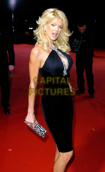 VICTORIA SILVSTEDT.Arrivals at World Music Awards 2006, Earls Court, London, UK..November 15th, 2006.half length black dress silver trim halterneck clutch purse zebra print.CAP/CAN.©Can Nguyen/Capital Pictures