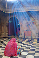 Karni Mata Temple , Deshnoke Rajasthan. The most intriguing aspect of the temple is the 20,000-odd rats that call this temple ... It was completed in its current form in the early 20th century in the late Mughal style by Maharaja Ganga Singh of Bikaner.<br /> <br /> The temple is thrown open to the public early in the morning at 4.00 a.m. Charan priests perform Mangla-Ki-Aarti and offer bhog (special food) as worship. A peculiar characteristic of the temple is the legion of rats roaming about in large numbers in the temple. They are considered auspicious and the devotees make offerings. Two kinds of offerings, the 'dwar-bhent' is attributed to the priests and the workers. The 'kalash-bhent' is utilised for the temple maintenance and development.