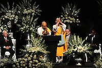 Buddhist monks chant at the memorial service for boxing legend Muhammad Ali at the KFC Yum! Center in Louisville, Kentucky on June 10, 2016.  Ali was involved in the planning of the ceremony which included speeches from leaders of numerous faith as well as comedian Billy Crystal and former American President Bill Clinton.