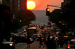 The sun sets down 34th Street in Manhattan 5/28/06.