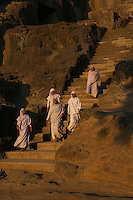 Buddhist Nuns visiting Ellora Caves Aurangabad, India.The famous Ellora caves are located in the lap of the Chamadari hills. These historical caves are regarded as world heritage and are situated 18 miles northwest of Aurangabad.  .A wonderful example of cave temple architecture, the world heritage Ellora caves own elaborate facades and intricately carved interiors. These carved structures on the inner walls of the caves reflect the three faiths of Hinduism, Buddhism and Jainism. These exotic caves were carved during 350 AD to 700 AD period. .Ellora caves are hewn out of basaltic rock of the Deccan trap, and are datable from circa 5th century A.D. to 11th century A.D. In all 34 caves were excavated here out of which Cave 1 to 12 are Buddhist, 13 to 29 are Brahmanical and 30 to 34 are Jaina.