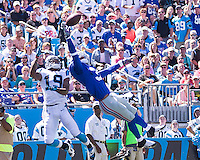 The Carolina Panthers played the New York Giants at Bank of America Stadium in Charlotte, NC.  The Panthers won 38-0 for their first victory of the season.  The Giants dropped to 0-3.  New York Giants cornerback Aaron Ross (31), Carolina Panthers wide receiver Ted Ginn (19)