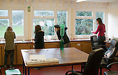 Andressa Cuginotti teaches a Chemistry class, Summerhill School, Leiston, Suffolk. The school was founded by A.S.Neill in 1921 and is run on democratic lines with each person, adult or child, having an equal say.  You don't have to go to lessons if you don't want to but could play all day.  It gets above average GCSE exam results.