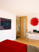 In keeping with the decorative style of the chalet's main living area, modern art also features on the walls of the guest bedrooms on the ground floor