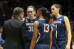 17 December 2013: UConn head coach Geno Auriemma (left) talks to starters Breanna Stewart (30), Brianna Banks (13), Moriah Jefferson (4), and Stefanie Dolson (right). The Duke University Blue Devils played the University of Connecticut Huskies at Cameron Indoor Stadium in Durham, North Carolina in a 2013-14 NCAA Division I Women's Basketball game. UConn won the game 83-61.