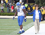UK tight end Tyler Robinson walks off the field after the University of Kentucky vs. Vanderbilt University football game at Vanderbilt Stadium in Nashville, Tenn., on Saturday, November 16, 2013. Vanderbilt won 22-6. Photo by Tessa Lighty | Staff