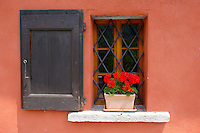 Couorful geramiuns in a rustic window - Val Verzasca - Ticino - Switzerland