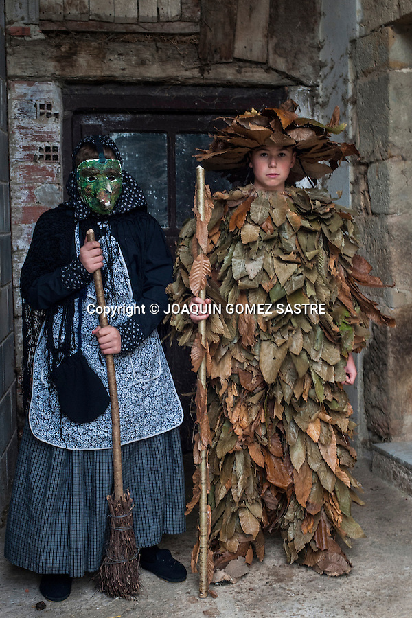 Two children dressed for carnival Vijanera, the first of the year to be held in Spain