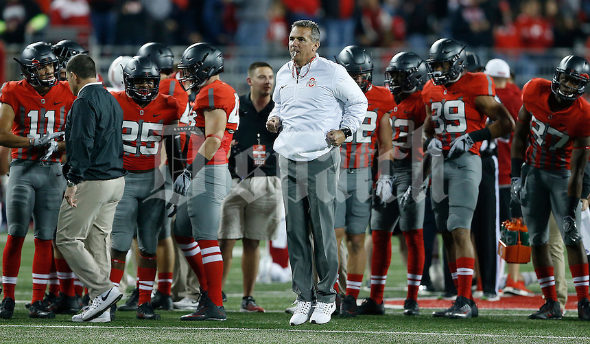Ohio State Buckeyes head coach Urban Meyer warms up before the NCAA football game between the Ohio State Buckeyes and the Nebraska Cornhuskers at Ohio Stadium in Columbus on Saturday, November 5, 2016. (Columbus Dispatch photo by Jonathan Quilter)