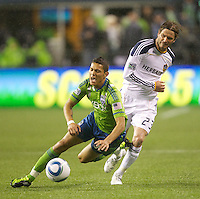 L.A. Galaxy midfielder David Beckham  fouls Seattle Sounders FC forward Miguel Montaño during play at Qwest Field in Seattle Tuesday March 15, 2011. The Galaxy won the game 1-0.