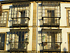 typical facade with windows protected of the wind and rain by glass balconies<br /> <br /> fachadas t&iacute;picas de Asturias con ventanas protegidas del viento y la lluvia con balcones de vidrio<br /> <br /> typisch asturische Fassaden mit Fenster die durch gl&auml;sernde Balkone vor Wind und Regen gesch&uuml;tzt werden