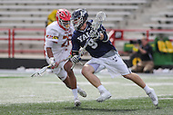 College Park, MD - February 25, 2017: Yale Bulldogs Lucas Cotler (9) is being checked by Maryland Terrapins Isaiah Davis-Allen (26) during game between Yale and Maryland at  Capital One Field at Maryland Stadium in College Park, MD.  (Photo by Elliott Brown/Media Images International)