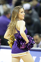 DEC 22, 2015:  Washington cheerleader Hailey Kiggins entertained fans during a TV timeout in the game against Seattle University. Washington defeated Seattle University 79-68 at Alaska Airlines Arena in Seattle, WA.