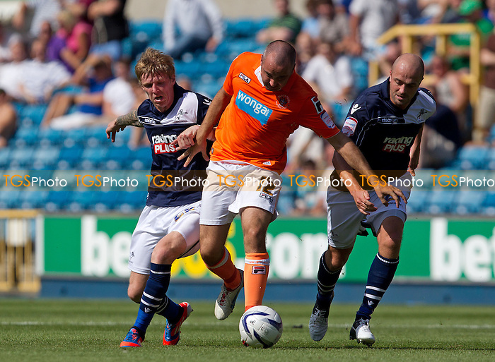 Gary Taylor-Fletcher of Blackpool tries to get in behind the Millwall defenders Andy Keogh and Jack Smith - Millwall vs Blackpool - NPower Championship Football at the New Den, London - 18/08/12 - MANDATORY CREDIT: Ray Lawrence/TGSPHOTO - Self billing applies where appropriate - 0845 094 6026 - contact@tgsphoto.co.uk - NO UNPAID USE.